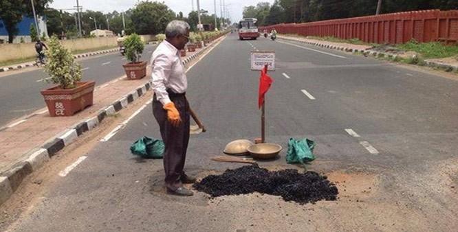 Man-Pothole-B