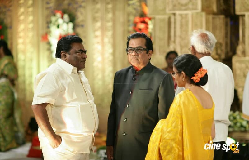 33. with his close friend Babu Mohan in wedding